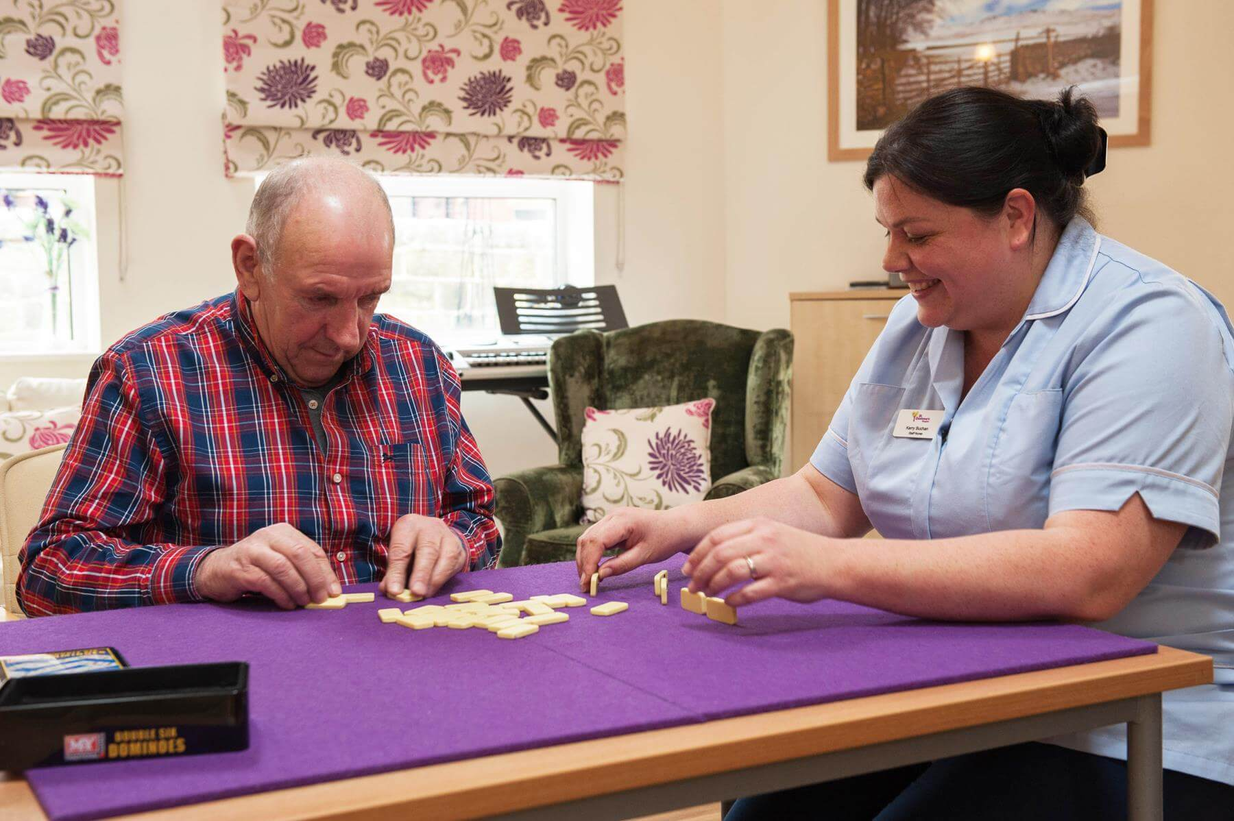Nurse and Patient Playing Dominoes
