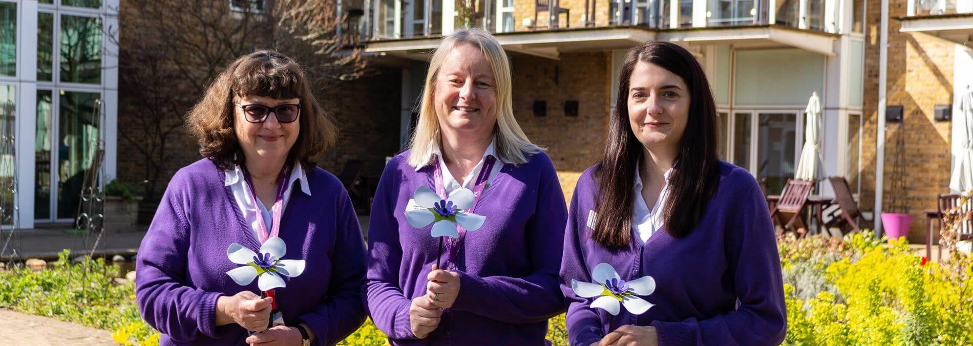 Community Nurses Holding Forever Flowers