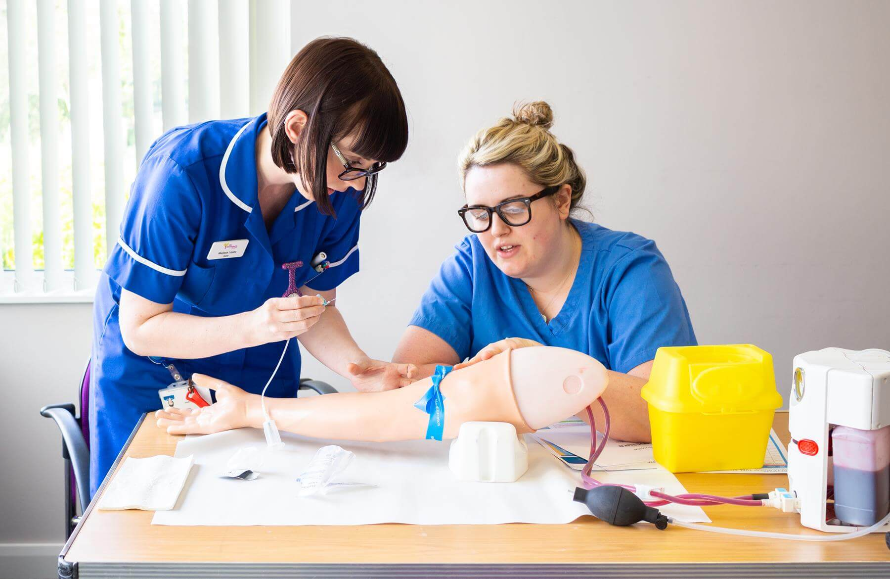 Two nurses in a training session