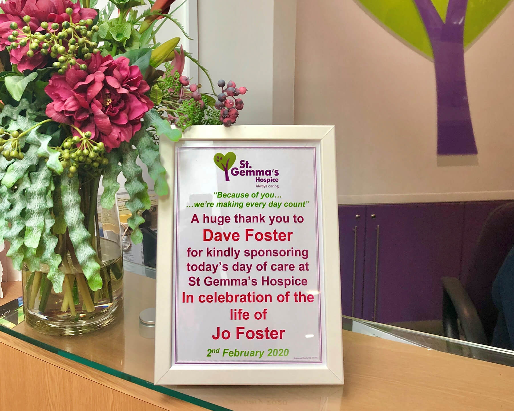 Sponsor a Day certificate in a frame