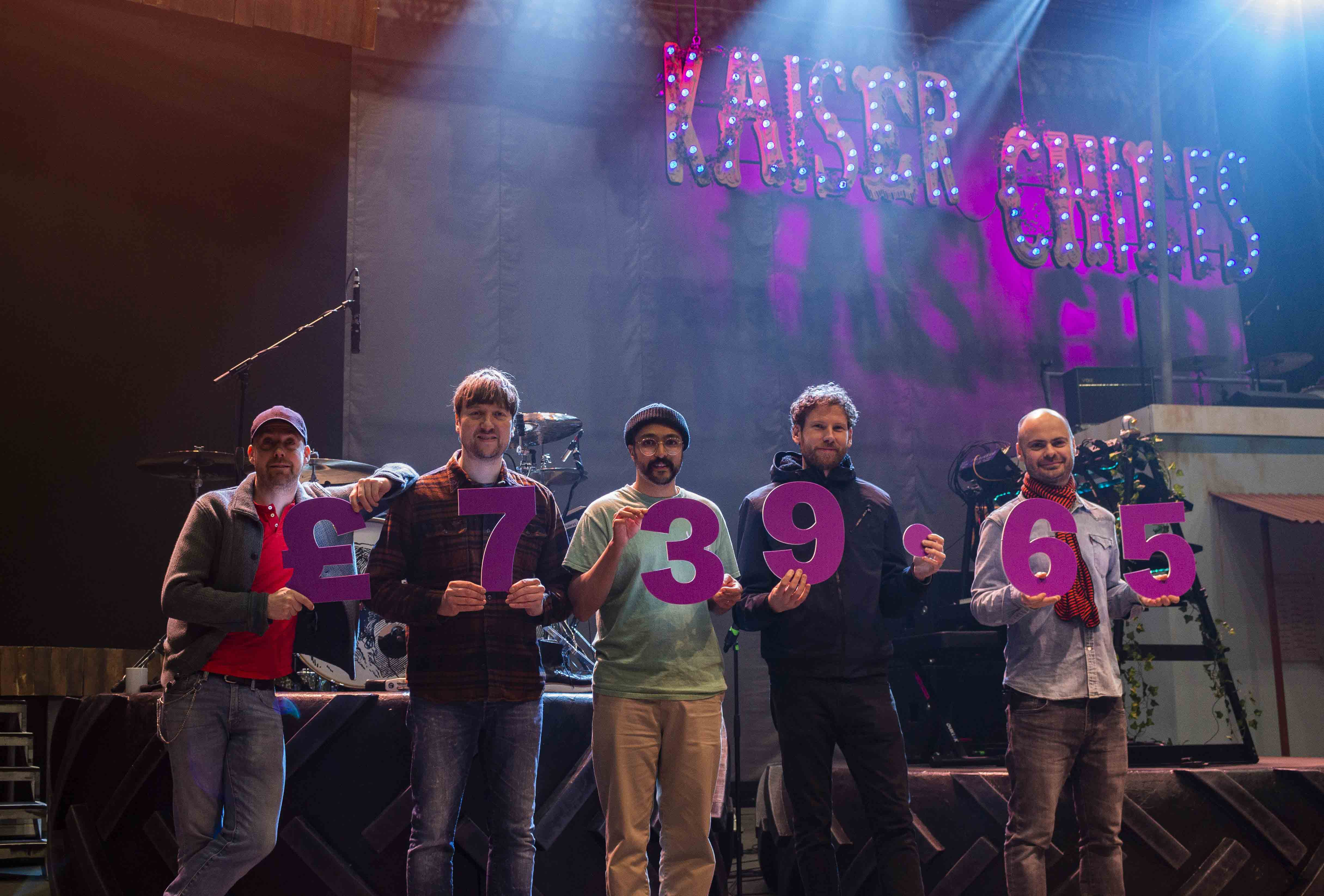 Kaiser Chiefs holding big purple numbers